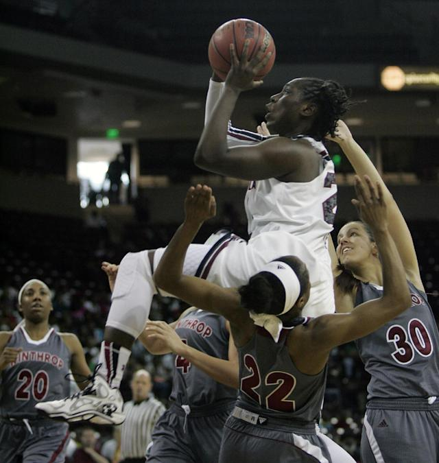 South Carolina's Aleighsa Welch (24) drives for the basket against Winthrop defenders during the first half of their NCAA college basketball game Friday, Dec. 20, 2013, in Columbia, SC. (AP Photo/Mary Ann Chastain)