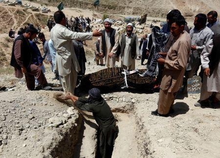 Relatives take part in a burial ceremony of the victims of yesterday's suicide attack in Kabul, Afghanistan July 25, 2017.REUTERS/Mohammad Ismail
