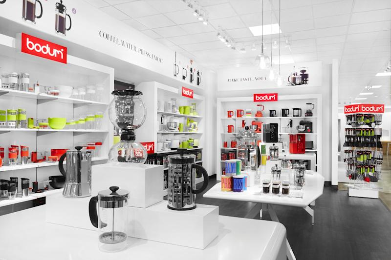 This undated image provided by J.C Penney shows a design for a new Bodum section in the home area of the department store. The struggling department store chain is set to unveil Friday, April 5, 2013, an overhauled home area that will feature a string of shops filled with such items as bright blue geometric-patterned pillows, stylish stainless steel tea kettles and sleek oak coffee tables. (AP Photo/J.C Penney, Chris Rupert)