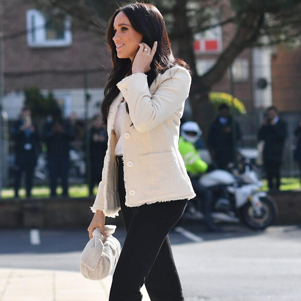 The Duchess of Sussex Me+Em cream boucle fringe jacket on International Women's Day 2020 - Getty Images