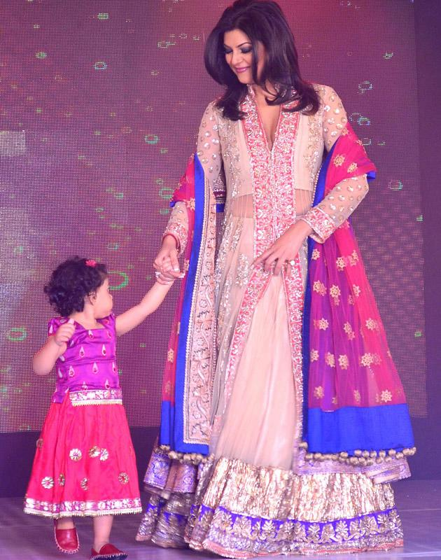 Sushmita walks with her little daughter