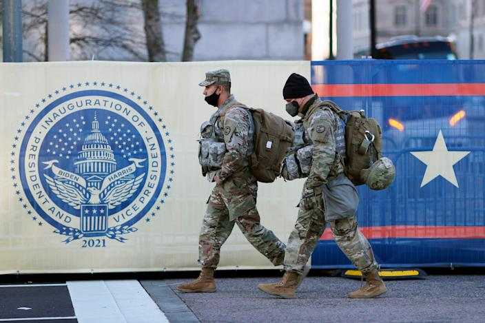 <p>National Guard walk around Washington the day after the inauguration of President Joe Biden on Thursday 21 January 2021, in Washington</p> ((Associated Press))