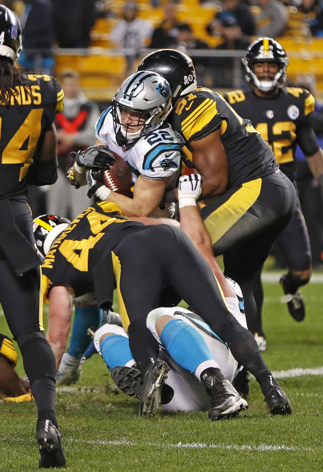 Carolina Panthers running back Christian McCaffrey (22) backs into the end zone for a touchdown during the second half of the team's NFL football game against the Pittsburgh Steelers in Pittsburgh, Thursday, Nov. 8, 2018. The Steelers won 52-21. (AP Photo/Don Wright)