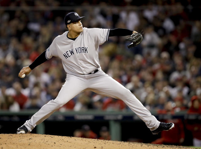 FILE - In this Oct. 6, 2018, file photo, New York Yankees relief pitcher Dellin Betances throws against the Boston Red Sox during the sixth inning of Game 2 of a baseball American League Division Series in Boston. Betances season appears over after just eight pitches. The Yankees say the reliever partially tore the Achilles tendon in his left foot when he hopped on the mound after striking out Brandon Drury, the second and final batter he faced in his season debut at Toronto. (AP Photo/Charles Krupa, File)
