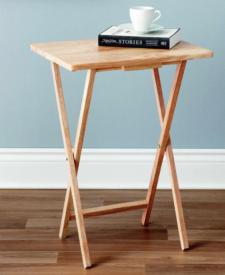 """<h2>Bed Bath & Beyond Snack Table</h2><br>Pair your handy folding stool with this even handier folding snack table and you've got yourself a convertible solo-dining setup your Zooming roomies will envy. <br><br><strong>Bed Bath and Beyond</strong> Single Stand Snack Table in Natural, $, available at <a href=""""https://go.skimresources.com/?id=30283X879131&url=https%3A%2F%2Fwww.bedbathandbeyond.com%2Fstore%2Fproduct%2Fsingle-stand-snack-table%2F5189827"""" rel=""""nofollow noopener"""" target=""""_blank"""" data-ylk=""""slk:Bed Bath and Beyond"""" class=""""link rapid-noclick-resp"""">Bed Bath and Beyond</a>"""