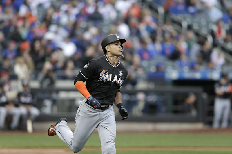 Giancarlo Stanton celebrated Matt Harvey's suspension with a two home run day. (AP Photo/Seth Wenig)
