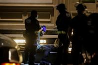 A looter is detained by police officers amid nationwide unrest following the death in Minneapolis police custody of George Floyd, in the Soho district of Manhattan, New York City