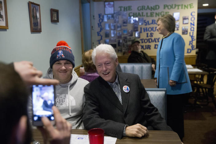 <p>Democratic presidential candidate Hillary Clinton and her husband, former President Bill Clinton, meet with customers before eating breakfast at Chez Vachon restaurant in Manchester, Feb. 8, 2016. <i>(Photo: Matt Rourke/AP)</i></p>