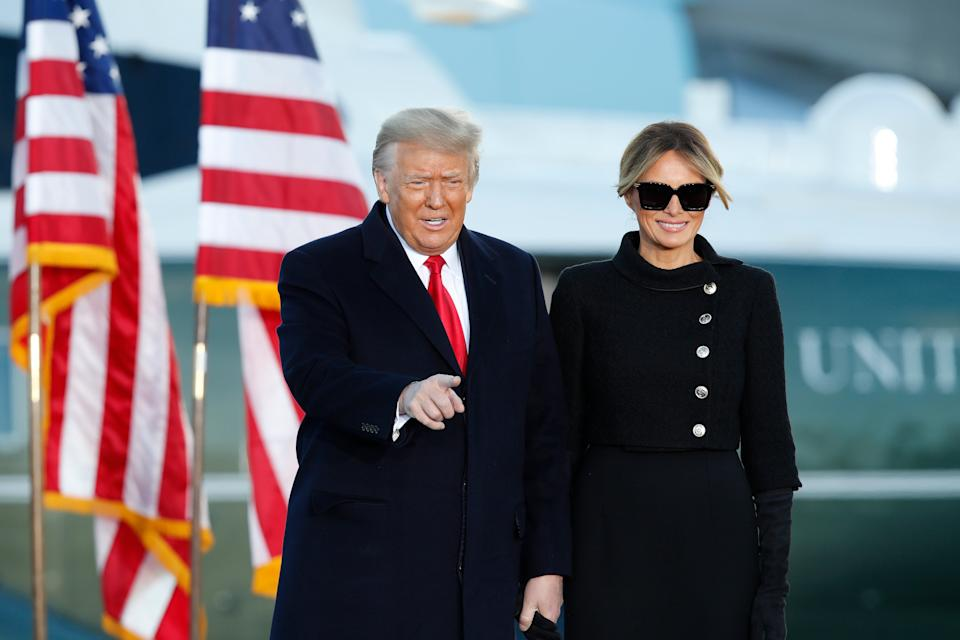 <p>Donald and Melania Trump greeting supporters at Andrews Air Force Base before leaving for Florida</p> (AP)