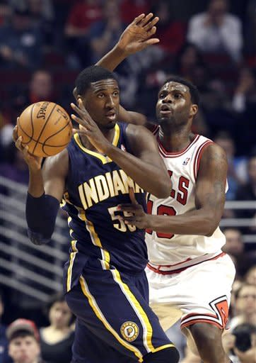 Indiana Pacers center Roy Hibbert (55) looks to a pass as Chicago Bulls center Nazr Mohammed (48) guards during the first half of an NBA basketball game in Chicago on Saturday, March 23, 2013. (AP Photo/Nam Y. Huh)