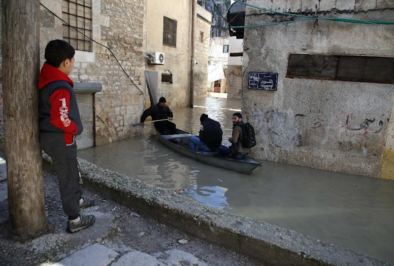 With water up to a metre and a half (five feet) deep inundating streets and the ground floors of many houses, the 49-year-old provides a valuable public serice to fellow townspeople -- and for free (AFP Photo/Aaref WATAD)