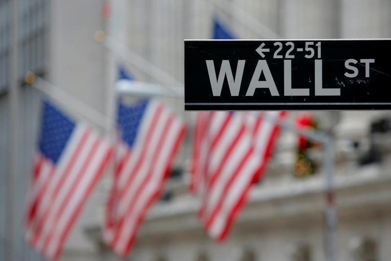 A street sign for Wall Street is seen outside the New York Stock Exchange in Manhattan, New York City