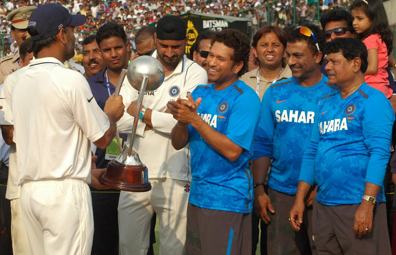 Indian Cricket team with the Border Gavaskar Trophy, after winning the Series between India & Australia, at Ferozeshah Kotla Stadium in Delhi on March 24, 2013. P D Photo by Dinesh Kumar