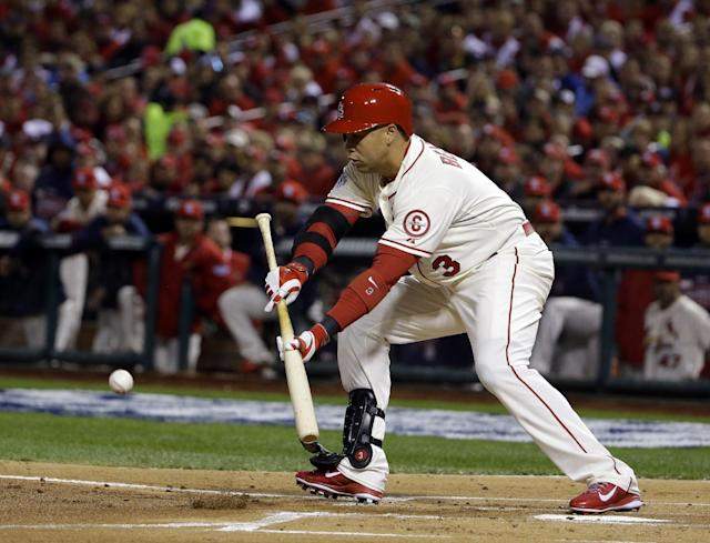 St. Louis Cardinals' Carlos Beltran bunts during the first inning of Game 3 of baseball's World Series against the Boston Red Sox Saturday, Oct. 26, 2013, in St. Louis. (AP Photo/Matt Slocum)