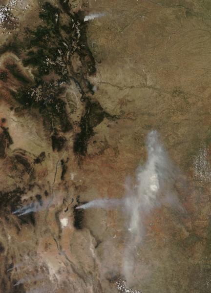 This June 10, 2012 satellite image provided by the NASA Goddard Space Flight Center shows wildfires in Colorado and New Mexico. The 68-square-mile High Park Fire near Fort Collins, Colo., is at top, with the 56-square-mile Little Bear fire, lower right, and 438-square-mile Gila fire, lower left, both in New Mexico, also visible. (AP Photo/NASA Goddard Space Flight Center)