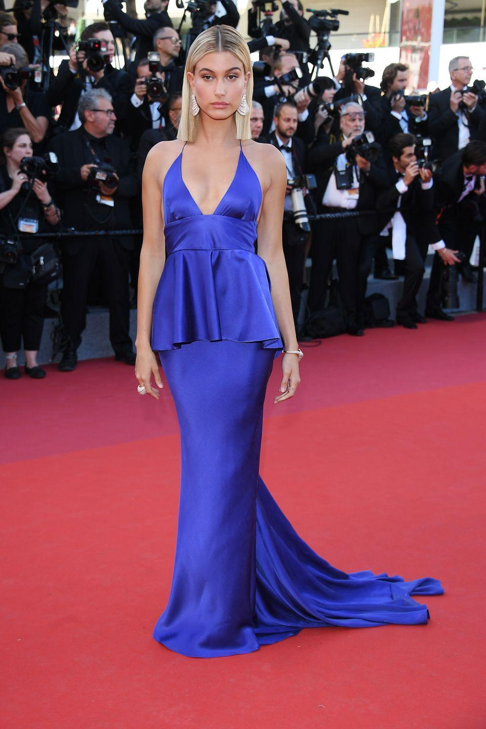 "<p>Hailey Baldwin<span class=""redactor-invisible-space""> wore an electric blue Twinset dress to attend the Ismael's Ghosts Cannes film premiere.</span></p>"
