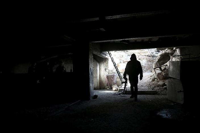 A rebel fighter in a tunnel on the outskirts of the Syrian capital Damascus on January 29, 2016 (AFP Photo/Amer Almohibany)