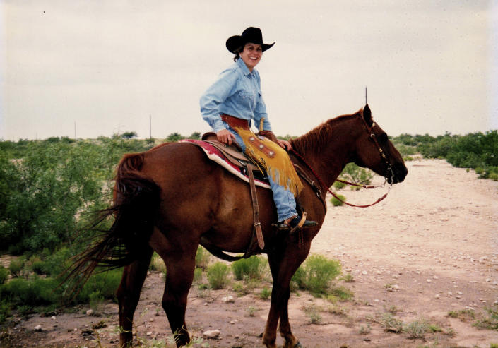 In this undated family photo provided by the Watt Family, Mary Williams Watt rides a horse on one of their ranch properties in west Texas. Watt died in 2018 following a diagnosis of adrenal cortical carcinoma, a rare cancer that affects the glands associated with the kidneys. Though not able to prove it, Watt's daughter, Ashley, wonders if toxic substances from abandoned oil wells on the property contributed to her mother's death. (Watt Family via AP)