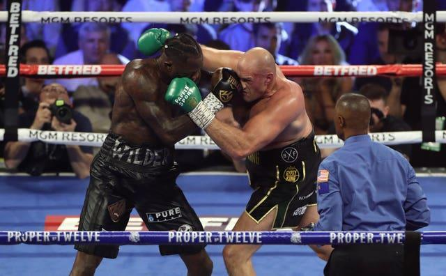 Tyson Fury, right, and Deontay Wilder fight for a third time on Saturday night (Bradley Collyer/PA)