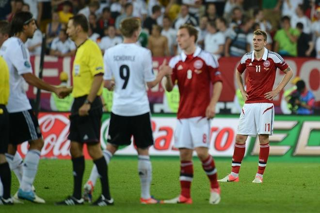 Danish forward Nicklas Bendtner (R) reacts at the end of the Euro 2012 football championships match Denmark vs. Germany, on June 17, 2012 at the Arena Lviv in Lviv.  Germany won 2-1. Denmark is out of the competition. AFP PHOTO / JEFF PACHOUDJEFF PACHOUD/AFP/GettyImages
