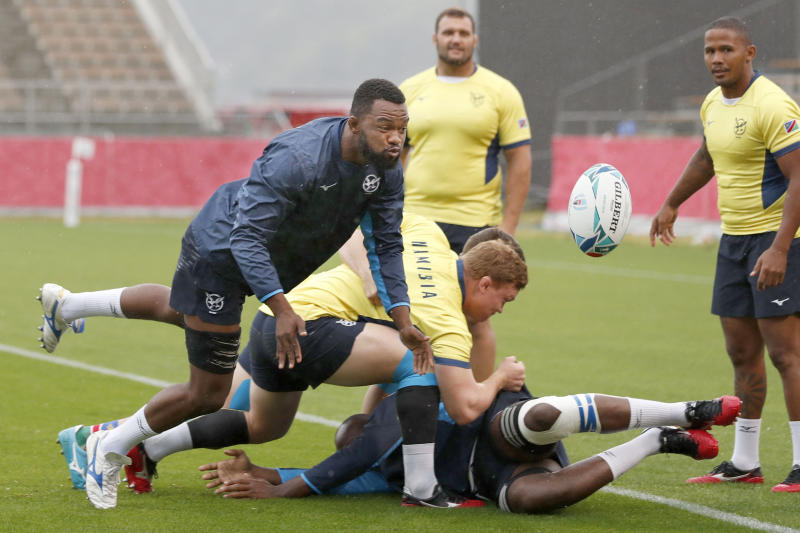 Namibia team's players work out ahead of their Rugby World Cup Pool B match against Canada Saturday, Oct. 12, 2019 in Kamaishi, northeastern Japan. (Kyodo News via AP)