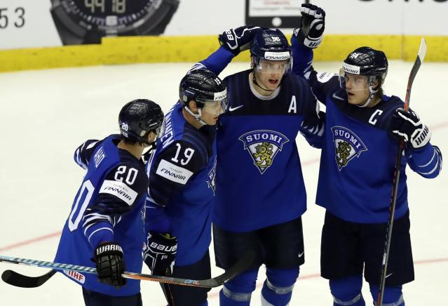 Ice Hockey - 2018 IIHF World Championships - Quarterfinals - Finland v Switzerland - Jyske Bank Boxen - Herning, Denmark - May 17, 2018 - Miko Rantanen of Finland celebrates with teammates after scoring. REUTERS/David W Cerny