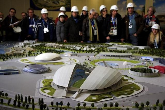 Journalists attend the presentation of a model of the Olympic Park on February 10, 2012, during a press trip at the Russian Black Sea resort of Sochi, venue of the 2014 Winter Olympics games. The Games will be the biggest international event hosted by Russia since the collapse of the Soviet Union but it faces the challenge of building much of the facilities from scratch in Sochi city and the surrounding mountains. Sochi will host the 2014 Winter Olympics which will start on February 7, 2014. (Photo by Fabrice Coffrini /AFP/Getty Images)