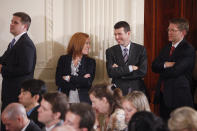 FILE - In this June 29, 2011 file photo, from left, White House Communications Director Dan Pfeiffer; Deputy Communications Director Jen Psaki; Senior Adviser David Plouffe; and Press Secretary Jay Carney stand in the East Room as President Barack Obama holds a news conference at the White House in Washington. (AP Photo/Charles Dharapak, File)
