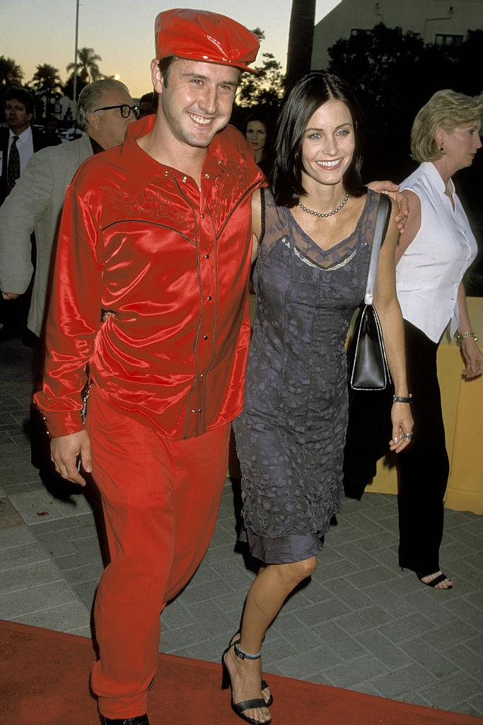 """David Arquette and Courteney Cox arrive at the premiere of the movie """"Snake Eyes"""" at Paramount Theatre on July 30, 1998 in Hollywood, California. (Photo: Jim Smeal/Ron Galella Collection via Getty Images)"""