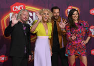 Philip Sweet, from left, Kimberly Schlapman, Jimi Westbrook, and Karen Fairchild of Little Big Town arrive at the CMT Music Awards at the Bridgestone Arena on Wednesday, June 9, 2021, in Nashville, Tenn. (AP Photo/John Amis)