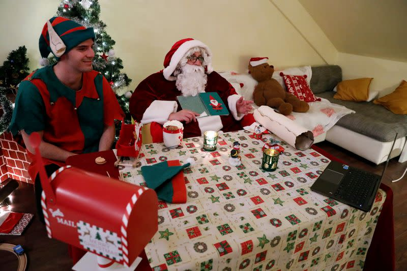 Pillmayer, dressed as Santa, talks as he interacts with children by video, amid the COVID-19 outbreak in Budapest