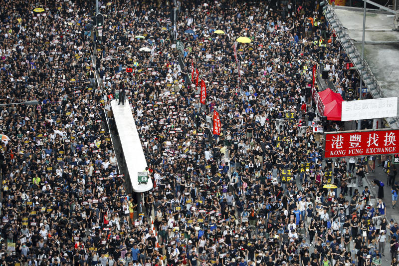 Protesters take part in a march on a street in Hong Kong, Sunday, July 21, 2019. Thousands of Hong Kong protesters marched from a public park to call for an independent investigation into police tactics. (Photo: Vincent Yu/AP)