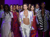 Models, including Gigi Hadid, center, walk the runway during the finale at the Brandon Maxwell spring/summer 2022 fashion show in the Brooklyn borough of New York during Fashion Week on Friday, Sept. 10, 2021. (Photo by Evan Agostini/Invision/AP)