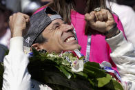 Helio Castroneves, of Brazil, celebrates after winning the Indianapolis 500 auto race at Indianapolis Motor Speedway, Sunday, May 30, 2021, in Indianapolis. (AP Photo/Paul Sancya)