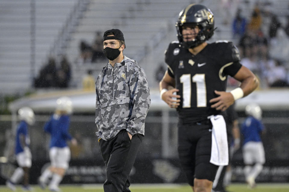 Central Florida quarterback McKenzie Milton, left, watches quarterback Dillon Gabriel (11) before an NCAA college football game against Tulsa, Saturday, Oct. 3, 2020, in Orlando, Fla. (AP Photo/Phelan M. Ebenhack)