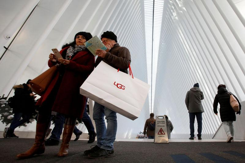 FILE PHOTO: People carry shopping bags during Black Friday sales events at the Westfield World Trade Center in Manhattan, New York City, United States