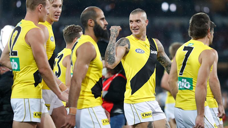 Dustin Martin and the Tigers are pictured walking from the field after their win over Port Adelaide in the AFL preliminary final.