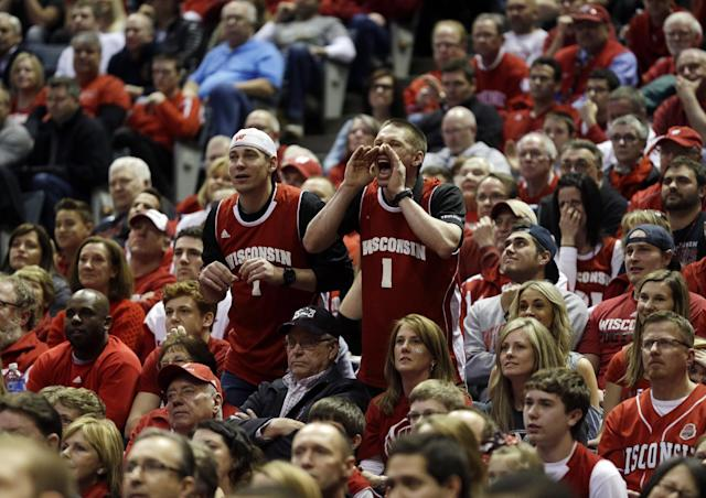 Wisconsin fans cheer during the first half of a third-round game against the Oregon of the NCAA college basketball tournament Saturday, March 22, 2014, in Milwaukee. (AP Photo/Morry Gash)