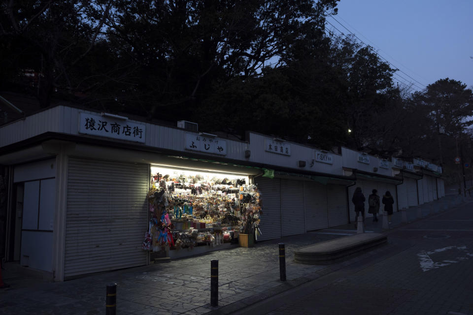 Tadayuki Takiguchi's souvenir shop remains open in Nara, Japan, March 17, 2020. Nara was among the first Japanese town hit by the COVID-19 in late January, when a tour bus driver in town tested positive for the virus, becoming the first Japanese patient after carrying tourists from Wuhan, the epicenter of the pandemic. (AP Photo/Jae C. Hong)