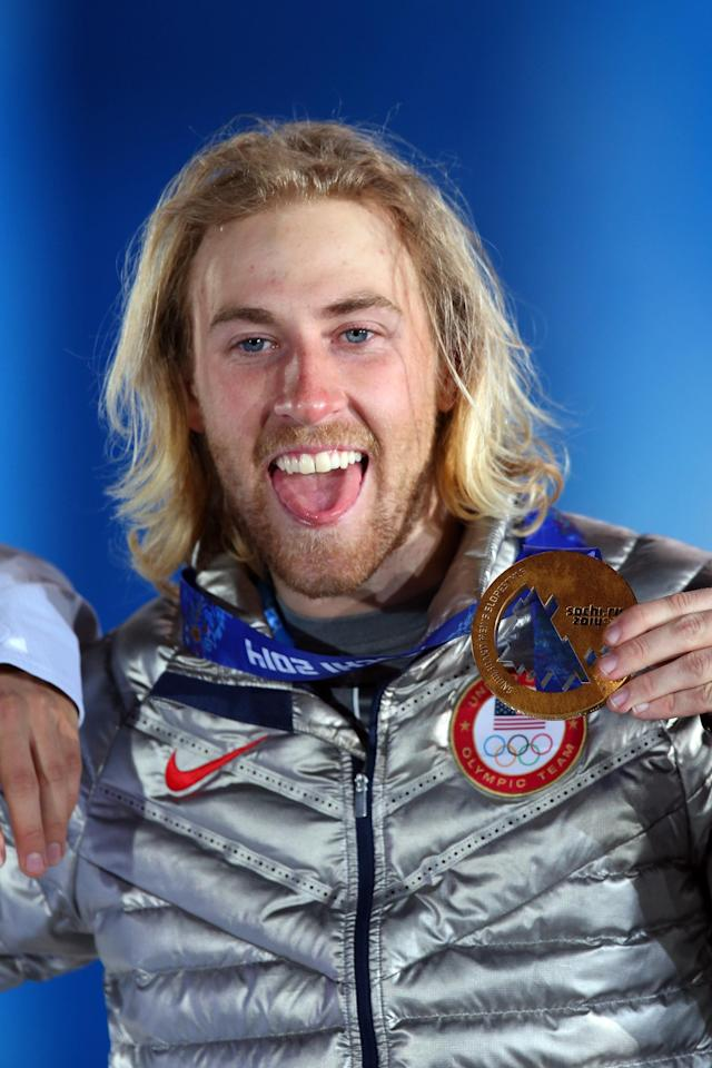 SOCHI, RUSSIA - FEBRUARY 08: Gold medalist Sage Kotsenburg of the United States celebrates during the medal ceremony for the Snowboard Men's Slopestyle during day 1 of the Sochi 2014 Winter Olympics at Medals Plaza on February 8, 2014 in Sochi, Russia. (Photo by Quinn Rooney/Getty Images)