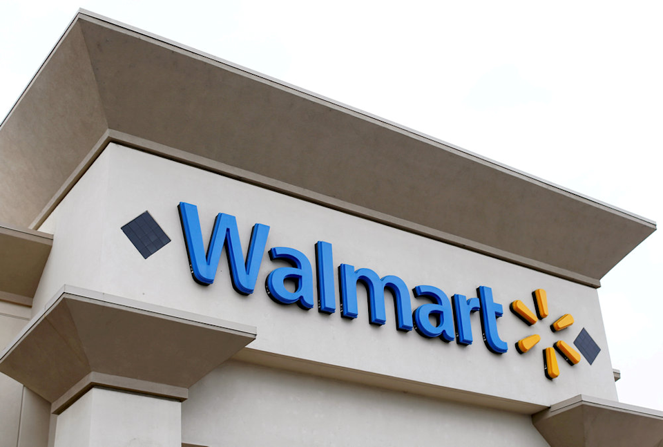 US retail giant Walmart will offer free college tuition and books to its 1.5 million employees in a bid to attract and retain workers in a tight labour market. — Reuters pic