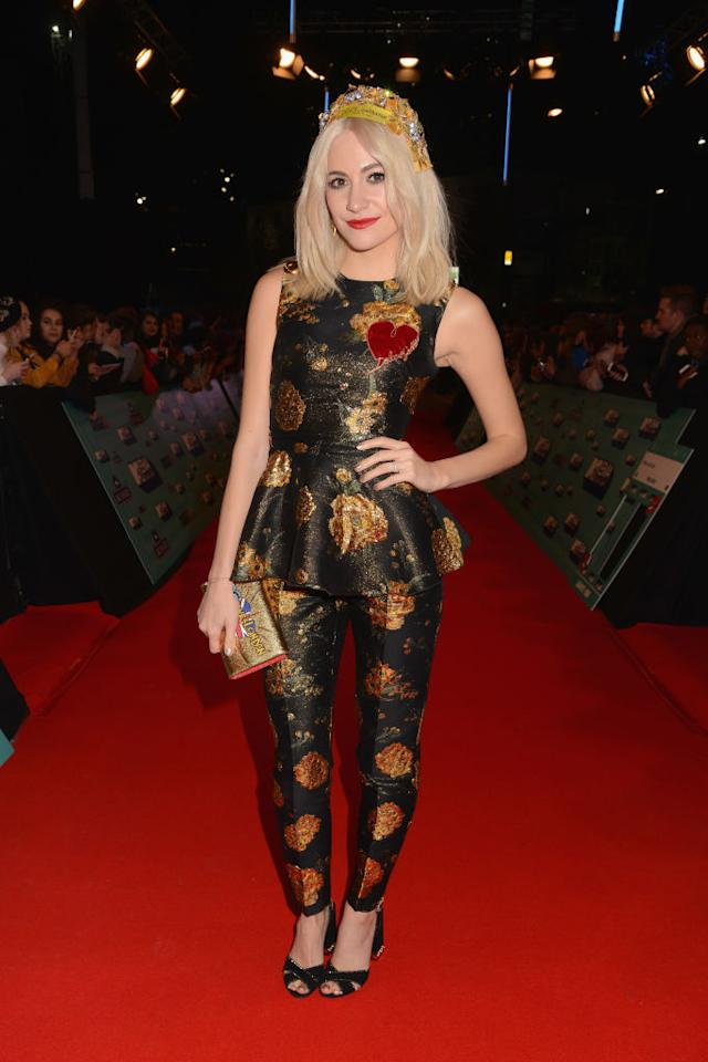 <p>Pixie Lott donned a peplum top and co-ordinating trousers by Dolce and Gabbana on the red carpet. And what better way to finish the look than with a crown by the Italian design duo? <em>[Photo: Getty]</em> </p>