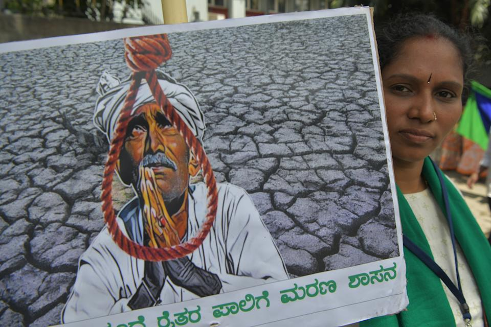 Activists belonging to various farmers rights organisations stage an anti-government demonstration to protest against the recent passing of new farm bills in parliament, in Bangalore on September 28, 2020. (Photo by Manjunath Kiran / AFP) (Photo by MANJUNATH KIRAN/AFP via Getty Images)