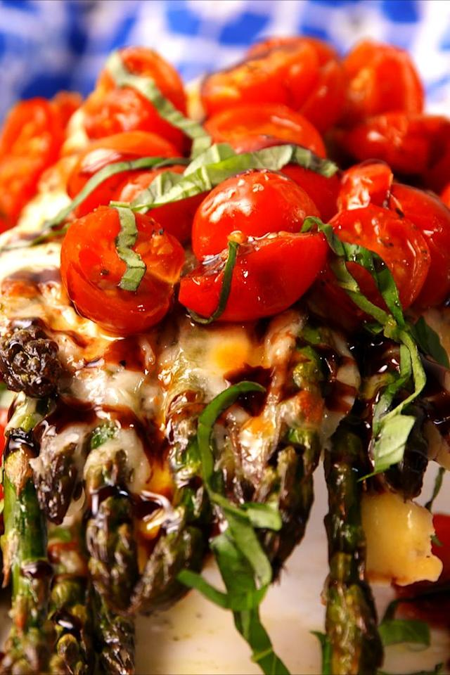 "<p>Everything's better caprese'd!</p><p>Get the recipe from <a href=""https://www.delish.com/cooking/recipe-ideas/recipes/a52836/caprese-asparagus-recipe/"" target=""_blank"">Delish</a>.</p><p><strong><strong><a class=""body-btn-link"" href=""https://www.amazon.com/Calphalon-Nonstick-Bakeware-Baking-2-Piece/dp/B008BUKO6G"" target=""_blank"">BUY NOW</a><em> Calphalon Nonstick Bakeware, $30, </em><em>amazon.com</em></strong></strong></p>"