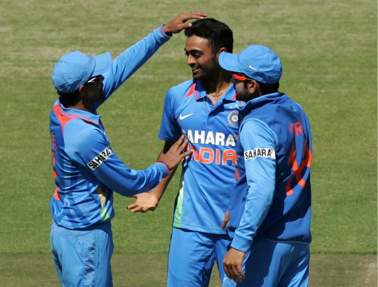 Indian bowler Shami Ahmed (C) celebrates a wicket with team mates during the first of five ODI series match between India and Zimbabwe at the Harare Sports Club on 24 July, 2013. AFP PHOTO / JEKESAI NJIKIZANA        (Photo credit should read JEKESAI NJIKIZANA/AFP/Getty Images)