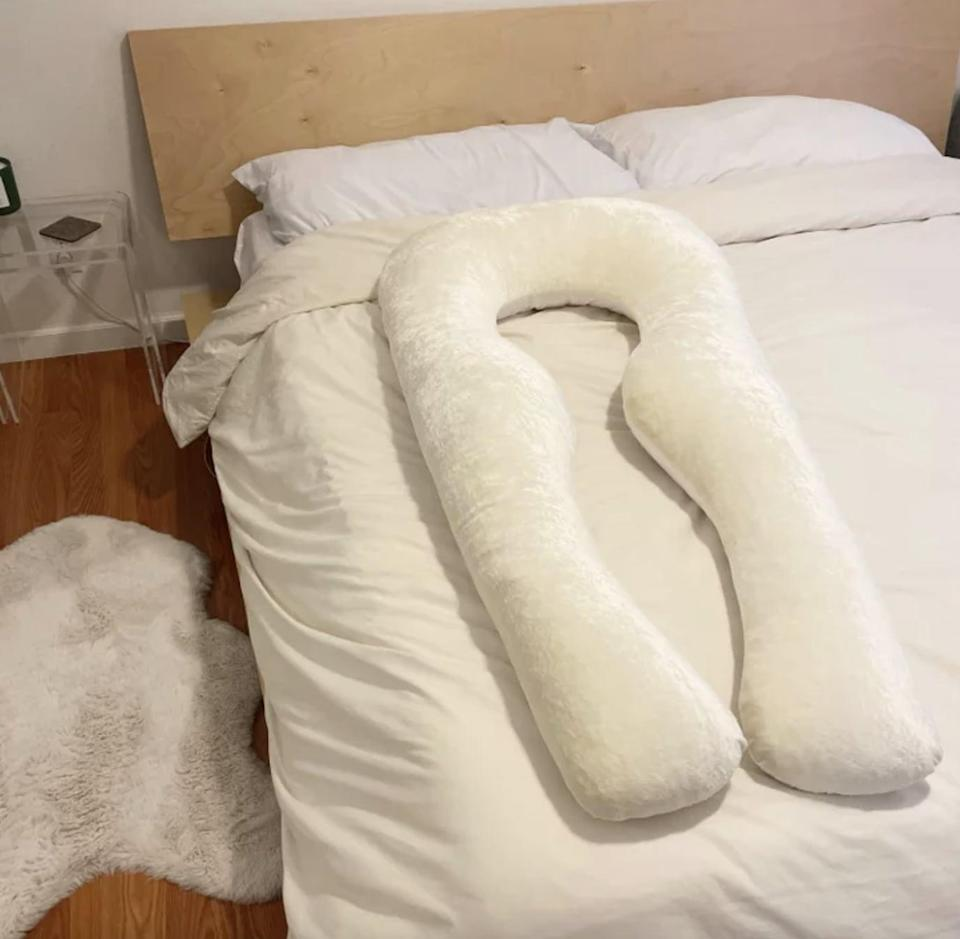 """<p>""""Sleeping was never an issue for me, but that changed this past year. I've been sleeping much less and in more uncomfortable positions, causing new neck and back pains. I recently got the chance to try the <span>Yana Premium Body Pillow</span> ($199), and after reading about it, I was excited to give it a shot and don't regret it. I used to find myself tossing and turning during the night, searching for the perfect position to fall asleep, and most of them ended up hurting my back. Resting in the pillow's unique silhouette gives my body a cozy sensation that doesn't tempt me to move around as much. As a result, it helps prevent me from getting stuck in uncomfortable positions, and I sleep so much more sound night after night."""" - KJ</p> <p>If you want to read more, here is the <a href=""""https://www.popsugar.com/smart-living/yana-pillow-review-48157623"""" class=""""link rapid-noclick-resp"""" rel=""""nofollow noopener"""" target=""""_blank"""" data-ylk=""""slk:Yana Premium Body Pillow"""">Yana Premium Body Pillow</a> review.</p>"""