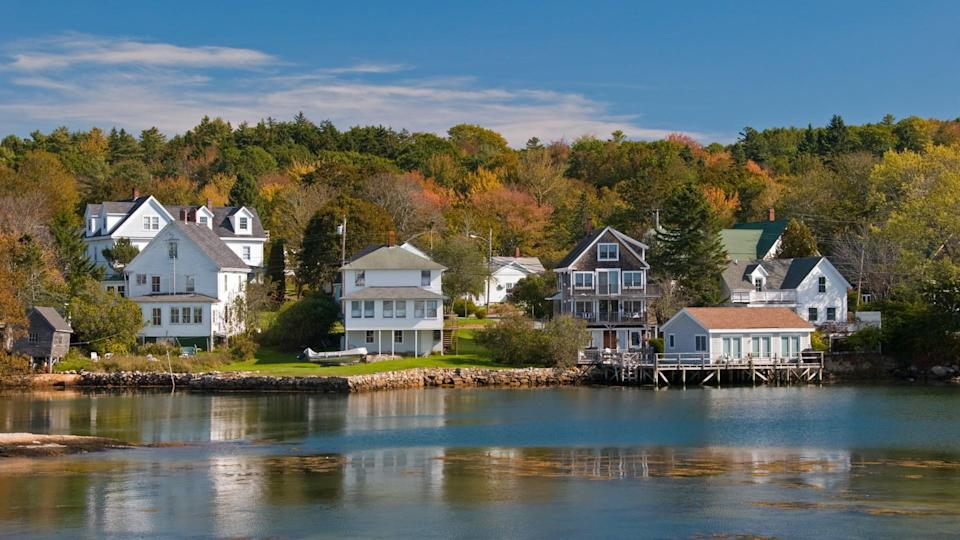 Victorian houses in a fall foliage setting in New England.