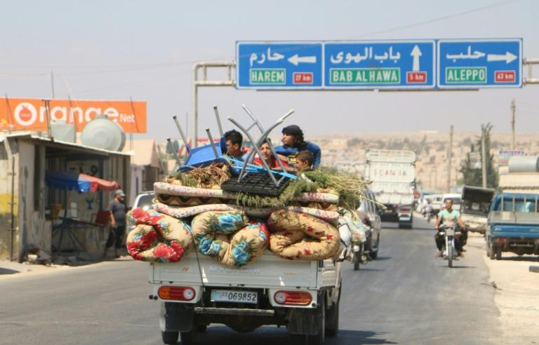 A Syrian family rides with their belongings in a pick up truck as they head to safer areas in the northern part of rebel-held Idlib province on September 6, 2018 to flee an expected regime assault