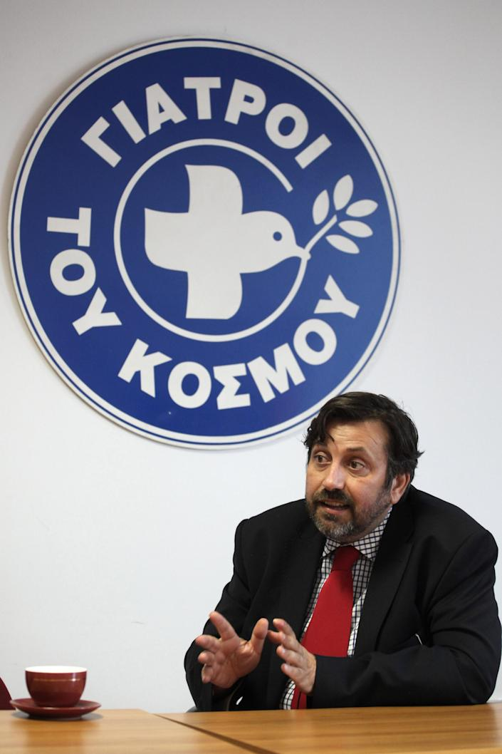 In this Oct. 24, 2012, photo, Nikitas Kanakis, head of Doctors of the World in Greece, describes how immigrants who have been the victims of racist attacks come to the organization's clinic in central Athens to be treated for their injuries. Human rights and immigrant groups say there has been an increase in racist attacks in Greece over the last year, as the country struggles through a protracted financial crisis. (AP Photo/Petros Giannakouris)