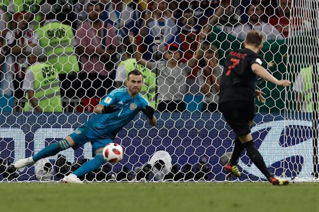 Rakitic scored the decisive penalty both times in shootout wins over Denmark and Russia (AFP Photo/Adrian DENNIS)